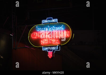 BANGKOK,THAILAND-JANUARY 20,2018: Sign for the Chinatown hotel in Bangkok. The neon sign is glowing against the darkened building. - Stock Photo