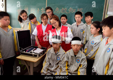 Shijiazhuang, Shijiazhuang, China. 9th May, 2018. Shijiazhuang, CHINA-8th May 2018: Pupils learn first aid skills from staff of Xinle Hospital in Xinle, north China's Hebei Province, marking World Red Cross and Red Crescent Day. Credit: SIPA Asia/ZUMA Wire/Alamy Live News - Stock Photo