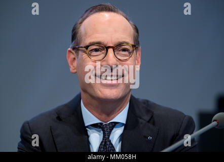 09 May 2018, Germany, Munich: CEO of the insurance company Allianz SE, Oliver Baete, sitting onstage before the begin of the annual general meeting of the insurance company Allianz. Photo: Sven Hoppe/dpa