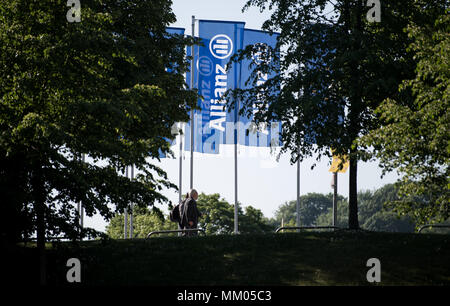 09 May 2018, Germany, Munich: Flags of the insurance company Allianz SE blowing in the wind before the begin of the company's annual general meeting in front of the Olympic Hall. Photo: Sven Hoppe/dpa