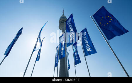09 May 2018, Germany, Munich: Flags of the insurance company Allianz SE blowing in the wind at the begin of the company's annual general meeting in front of the Olympic Hall. Photo: Sven Hoppe/dpa