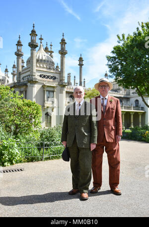 Brighton UK 9th May 2018 - Renowned artists Gilbert (left) and George in the Royal Pavilion Gardens in Brighton before visiting their exhibition at Brighton Museum and Art Gallery which is showing until September until September .  Photograph taken by Simon Dack Credit: Simon Dack/Alamy Live News - Stock Photo