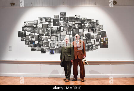 Brighton UK 9th May 2018 - Renowned artists Gilbert (left) and George visiting their exhibition at Brighton Museum and Art Gallery which is showing until September until September .   Credit: Simon Dack/Alamy Live News - Stock Photo