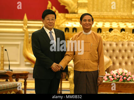 Nay Pyi Taw, Myanmar. 9th May, 2018. Visiting Chinese State Councilor and Minister of Public Security Zhao Kezhi (L) shakes hands with Myanmar President U Win Myint in Nay Pyi Taw, Myanmar, on May 9, 2018. Credit: U Aung/Xinhua/Alamy Live News - Stock Photo
