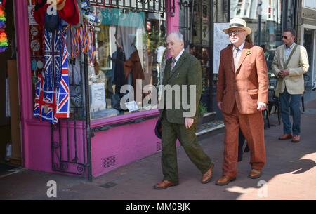 Brighton UK 9th May 2018 - Renowned artists Gilbert (left). and George walking around the North Laine area of Brighton before visiting their own exhibition at Brighton Museum and Art Gallery which is showing until September until September .  Photograph taken by Simon Dack - Stock Photo