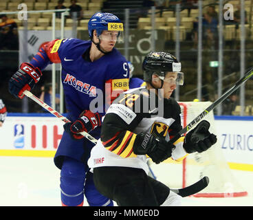 May 9, 2018 - Herning, Denmark - from left William YOUNG (KOR), Dominik KAHUN (GER), .May 09, 2018, Ice Hockey World Championship 2018,Germany vs Korea, Jyske Bank Boxen, Herning/Denmark, (Credit Image: © Wolfgang Fehrmann via ZUMA Wire) - Stock Photo