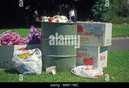Over flowing rubbish bin following concert in the park, Sydney, NSW, Australia - Stock Photo