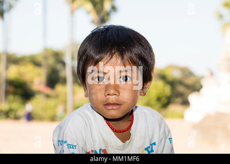 Bagan, Myanmar, December 29, 2017:  Pretty girl with Tanaka in the face looks expectantly into the camera in Bagan, Myanmar - Stock Photo
