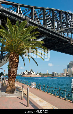 View eastward under the Sydney Harbour Bridge toward the Opera House - Stock Photo