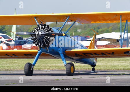 A vintage Boeing Stearman biplane parked on the tarmac at the Abingdon Air& Country Show - Stock Photo