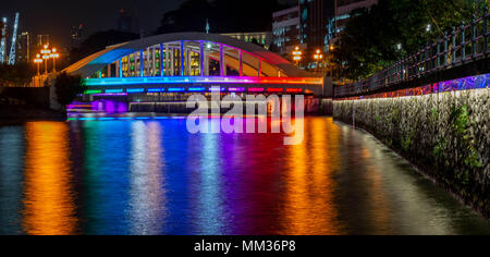 Rainbow reflections in the Singapore River from the Elgin Bridge - Stock Photo