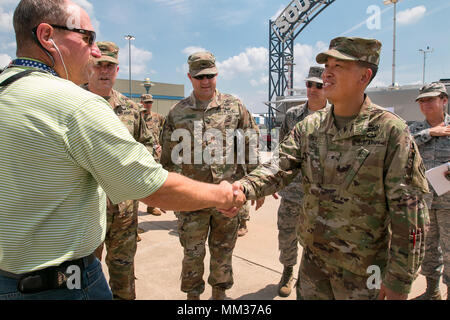 Brig. Gen. Mark Toy, deputy commanding general-support (DCG-S), Joint Forces Land Component Command (Forward), Hempstead, Texas, (JFLCC-FWD), meets with a Federal Emergency Management Agency (FEMA) representative during a site recon of Beaumont to discuss the current efforts being made in response to Hurricane Harvey on Sep. 4, 2017. Assigned as one of two Deputy Commanding Generals, Toy serves as the senior engineer advisor to the JFLCC-FWD commander as local/state/federal response efforts transition from search and rescue to the recovery phase. The Department of Defense is conducting Defense - Stock Photo