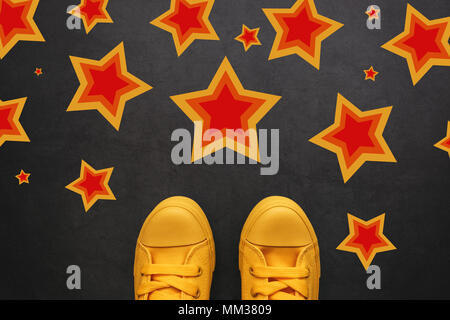 Talent, vip, prize and award concept - young teenage person standing on the road with star shape imprints -