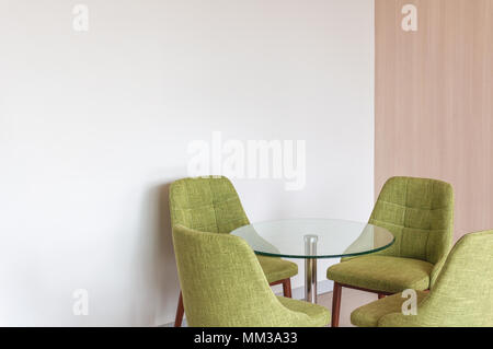 Close up green chair modern style on white concrete corner background - Stock Photo