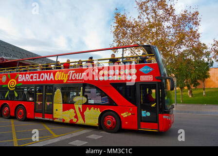 Barcelona City Tour, sightseeing bus passing Camp Nou stadium, Barcelona, Catalonia, Spain - Stock Photo