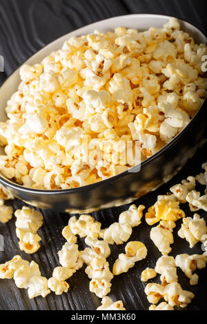 popcorn cheese in a bowl closeup on a table. vertical - Stock Photo