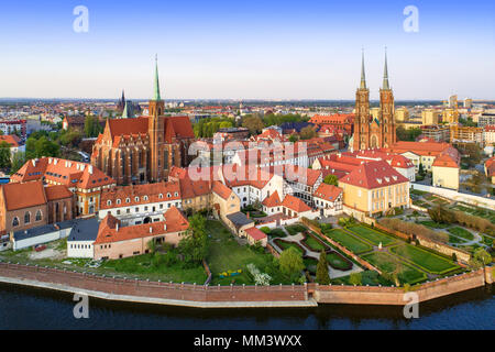 Poland. Wroclaw. Ostrow Tumski district with Gothic cathedral of St. John the Baptist,  Collegiate Church of the Holy Cross and St. Bartholomew and Od - Stock Photo