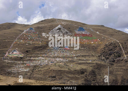 Hundreds of prayer flags above the Tagong Grasslands, Sichuan, China - Stock Photo