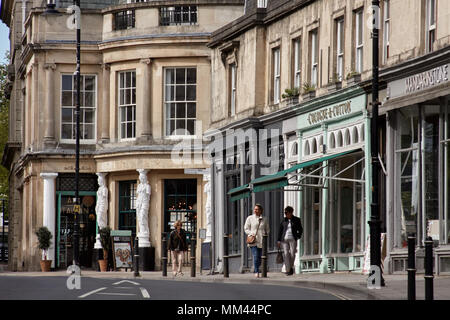 Pedestrians walking past shops and bars / restaurants in the Montpellier district of Cheltenham, Gloucestershire. - Stock Photo