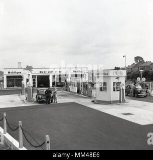 1960, historical picture, exterior, of The Whirlwind, a Mobilgas full service station with repair garage on-site, and with forecourt attendants available to give assistance to customers at the petrol pumps, West London, England, UK. - Stock Photo