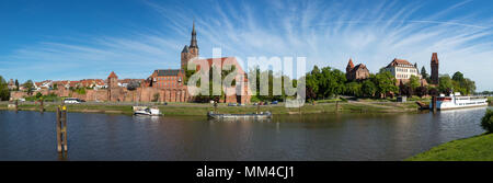 Panoramic view of Tangermünde on Elbe river with city wall, St Stephens church, castle and retired river cruise ship - Stock Photo