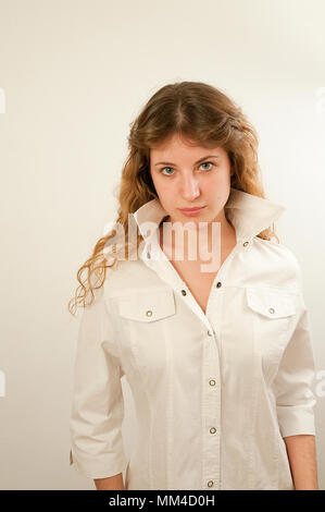 Young woman looking at the camera. - Stock Photo
