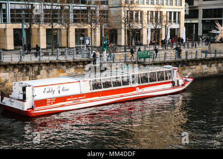 Berlin, February 15, 2018: Tourist boats cruise along the river Spree in Berlin, past sights. - Stock Photo