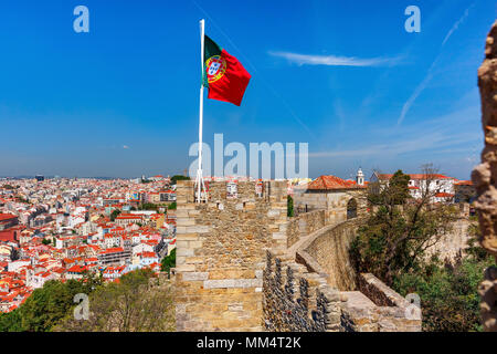 Portuguese flag on fortress wall, Lisbon, Portugal - Stock Photo