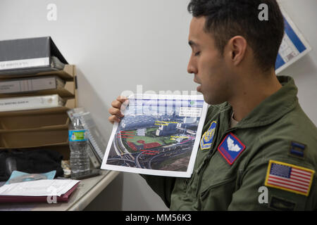 Capt. Jonathan Bonilla, 459th Airlift Squadron UH-1N operations flight commander, shows a planned landing zone during a mission briefing at Yokota Air Base, Japan, Sept. 3, 2017. Airmen with the 459 AS picked up simulated disaster relief supplies at the Tokyo Rinkai Disaster Prevention Park during the Annual Tokyo Metropolis Comprehensive Disaster Prevention Drill. The park is located in the Airake area and is a disaster countermeasure headquarters of the Government of Japan and other local government agencies during large-scale earthquakes in the metropolitan area. (U.S. Air Force photo by Ya - Stock Photo
