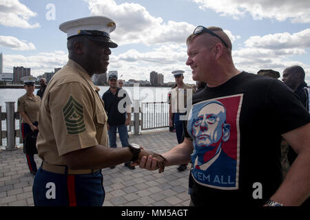 Sgt. Maj. of the Marine Corps, Ronald L. Green, greets retired U.S. Marine Corps Sgt. Maj. Paul Kraus during Marine Week Detroit, Sept. 8, 2017. Marine Week Detroit is a chance to connect with our Marines, Sailors, veterans and their families from different generations. (U.S. Marine Corps photo by Lance Cpl. Danny Gonzalez) - Stock Photo