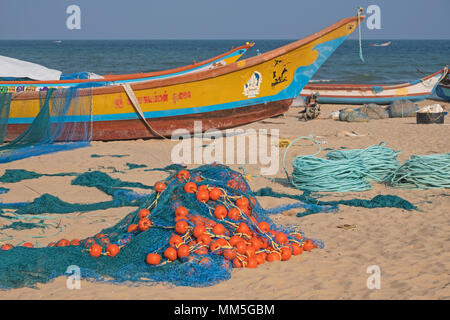 Fishing boats and their gear on a beach at Mamallapuram in Tamil Nadu. The main catches in the Bay of Bengal inshore fishery are prawns and pomfrets - Stock Photo