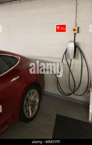 Tesla electric car charging inside the underground multi storey / level car park operated by Q park in Cavendish Square. London. W1G 0PN. UK. (96) - Stock Photo