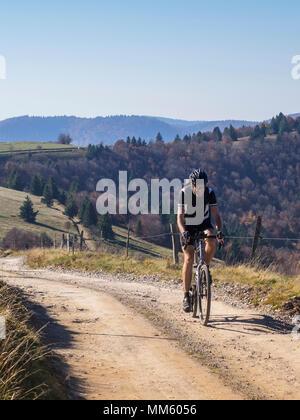 Cyclocross rider on cycling tour near Grand Ballon, Vosges, France - Stock Photo