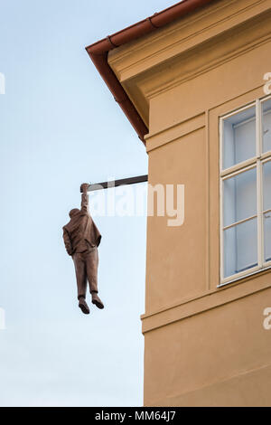Prague, Czech Republic - May 28, 2016: View of the Hanging Man sculpture dedicated to Sigmund Freid made by sculptor David Cerny. - Stock Photo
