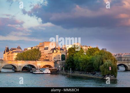 View along River Seine of Ile-de-la-Cite, with the Conciergerie and the tower of Sainte Chapelle, Paris, France - Stock Photo