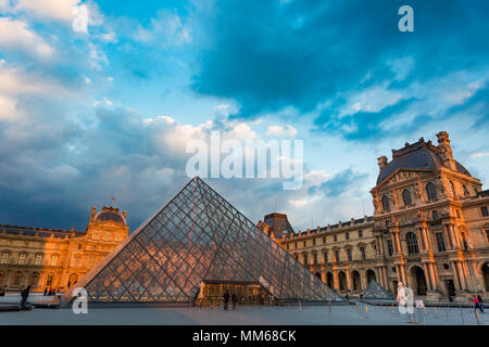 Evening sky at sunset over the courtyard of Musee du Louvre, Paris, France - Stock Photo