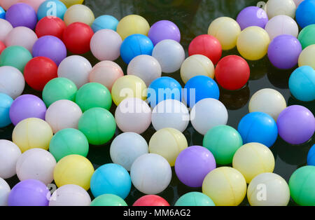 Inflatable balls on the surface of a children's play pond in Chaoyang Park, Beijing, China - Stock Photo