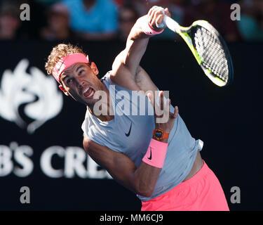 Spanish tennis player Rafael Nadal  playing service shot at Australian Open 2018 Tennis Tournament, Melbourne Park, Melbourne, Victoria, Australia.
