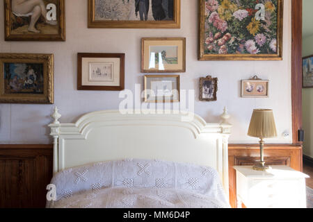 Bedroom Interior with Art Collection  in Giverny , Claude Monet's house and Gardens in Giverny, France - Stock Photo