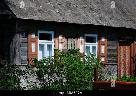 Small wooden house on Lubelskie region in Poland. Rural Architecture. - Stock Photo