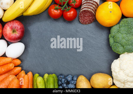 Fruits and vegetables food collection frame slate copyspace from above top view - Stock Photo