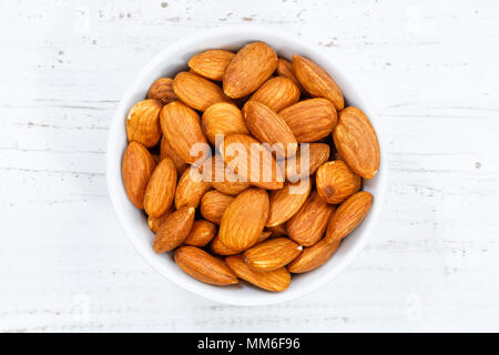 Almonds almond from above bowl wooden board wood - Stock Photo