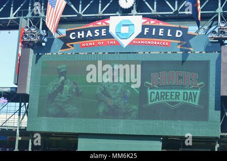 Sgt. Jared Prizmich (left), recruiter, Chandler Recruiting Center, Phoenix Central Recruiting Company, and Staff Sgt. Brendan Martin (right), recruiter Chandler Recruiting Center, Phoenix Central Rec. Co., are displayed on the big screen at the annual Arizona Diamondbacks Career Day, Sept. 12, Chase Field, Phoenix. (U.S. Army photo by Alun Thomas, USAREC Public Affairs) - Stock Photo