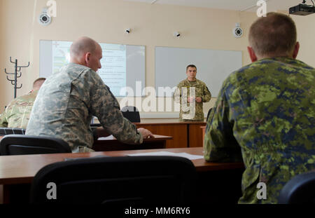 Canadian, Lithuanian, Polish and United States service members reviewed several local considerations in a civil affairs brief as part of Rapid Trident 17, Sept. 14, 2017, at the International Peacekeeping Security Center in Yavoriv, Ukraine. - Stock Photo