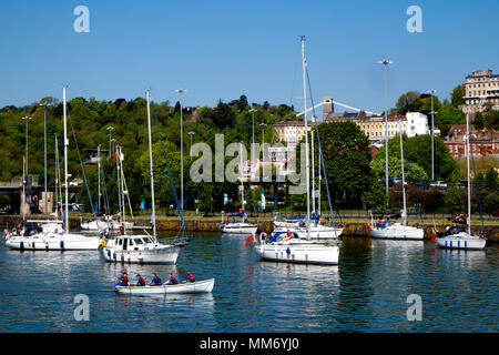 A flotilla of boats waits in the Cumberland Basin, Bristol for the second of two swing bridges to open enabling access to the city's Floating Harbour. - Stock Photo