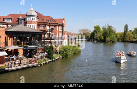 View down stream from Windsor and Eton Bridge over the River Thames in Windsor Royal Berkshire - Stock Photo