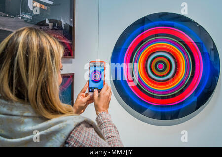 Hampstead, London, UK. 9th May, 2018. Targets by Franco Defrancesca - The Affordable Art Fair opens in Hampstead and runs until 14 May. The fair offers visitors a chance to purchase work from over 110 galleries at prices between £100 and £6,000 Credit: Guy Bell/Alamy Live News - Stock Photo
