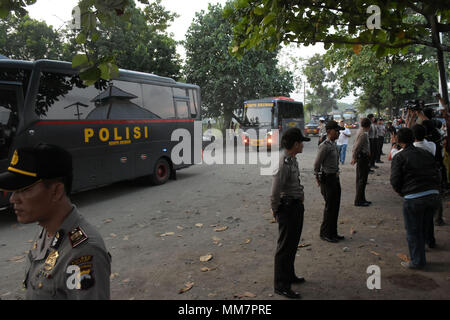 (180510) -- CILACAP, May 10, 2018 (Xinhua) -- Indonesian police officers stand by some buses with terrorist prisoners arriving at Nusakambangan prison, Cilacap, Indonesia, on May 10, 2018. As many as 155 terrorist inmates that had surrendered after the riot in Mobile Brigade Headquarters in Depok were moved to Nusakambangan Prison, Cilacap, Central Java. (Xinhua/Dian A.) (zxj) - Stock Photo