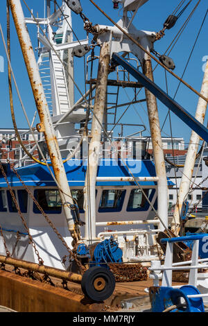 A trawler alongside in the fishing fishermen dock at Portsmouth harbour on the south coast of the uk. Trawlers and trawling ships in port Portsmouth. - Stock Photo