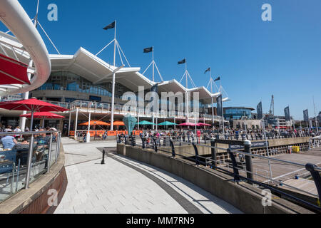 the restaurants and bars with shopping designer outlets at gunwharf quays shopping centre on the waterfront of portsmouth harbour on the south coast, - Stock Photo